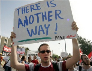 Israeli citizen carries a sign calling for peace.