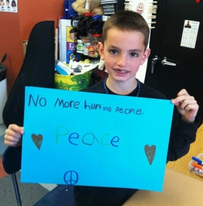 8-year-old Martin Richard killed in the Boston Marathon bombing, holding this sign has come to symbolize the tragedy worldwide. Martin's dad ran in the marathon. Martin's mom and sister were also seriously injured.
