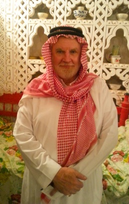 Sam dressed in thobe and shemagh with egal at the national Saudi Janadriyah Festival.