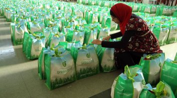 Noor Khan helps load food bags for different charities that were picking up the donated food bags at the Al Hijra School in Windsor, Ontario, Canada. The food and cash donations were collected by the local Muslim community.