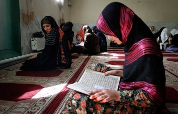 Men and women seek to draw closer to God through prayer and reading the Qur'an.