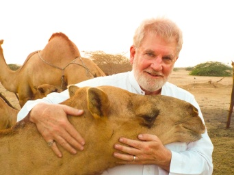 "Sam with his adopted camel ""Leila"" in the Arabian desert near Jeddah, Saudi Arabia."