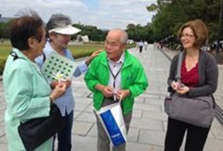 Akemi Yagi and Shouzou Kawamoto share their stories with visitors in the Hiroshima Memorial Peace Park. Both have dedicated their lives to promoting world peace and nuclear disarmament.