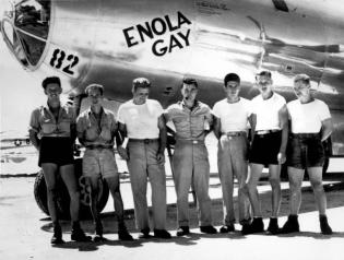 The flight ground crew with Enola Gay pilot Col. Paul Tibbets. The plane would deliver the first atomic bomb to ever be used in war.