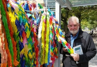 Sam with paper cranes mailed by school children from around the world in remembrance of Sadako and to promote world peace.