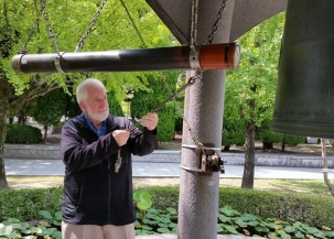"Sam is privileged to rink the Peace Bell in Hiroshima's Peace Park. ""I rang it with the Middle East in mind,"" he says."
