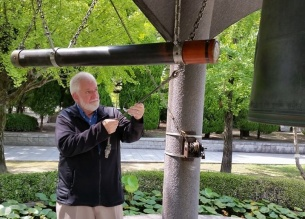 """Sam is privileged to rink the Peace Bell in Hiroshima's Peace Park. """"I rang it with the Middle East in mind,"""" he says."""