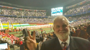 Sam flashes peace sign at the opening ceremony of the World Peace Summit in Seoul.