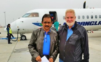 Sadi and Sam prepare to board flight to far-south Bangladesh.