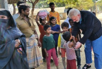am is greeted by children of the Kutupalong refugee camp.