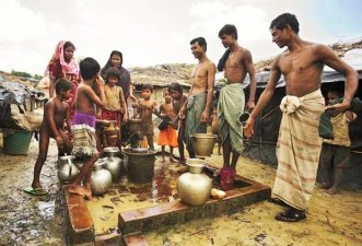 Rohingya men and women retrieve water