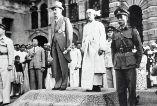 The British governor, left , and Burma's first president, Sao Shwe Thaik, stand at attention as the new nation's flag is raised on January 4, 1948.