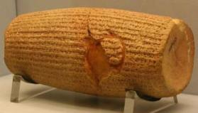 The decrees Cyrus the Grreat made on human rights were inscribed in the Akkadian language on a baked-clay cylinder. It is the first known attempt to innumerate the rights and privileges of peoples.
